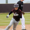 A Cashion runner rounds third for home as they defeat the Pioneer Mustangs 10-0 at Pioneer High School's John D. Riesen Field during the OSSAA Class A Regional Friday, April 26, 2013. (Staff Photo by BONNIE VCULEK)