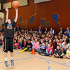 Taurion Sullivan shows his shooting style Wednesday at Taft Elementary during a send off assembly. Sullivan is headed to Springfield, MA to compete in a national free throw shooting contest. (Staff Photo by BILLY HEFTON)