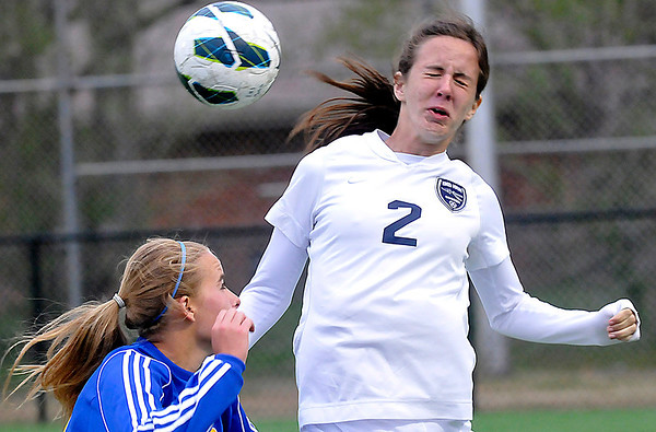 Enid's Audrey Merz heads the ball away from a Stillwater defender Tuesday at D. Bruce Selby Stadium. (Staff Photo by BILLY HEFTON)