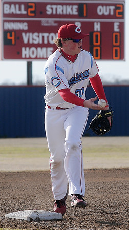 Chisholm's Garron Nixon snags a ball and steps on third for a double play in the fourth inning against Watonga Friday, April 12, 2013. (Staff Photo by BONNIE VCULEK)