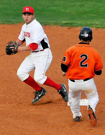 NOC-Enid's Chase Knott readies to throw to first for a doubleplay after forcing out Connors State's Yariel Gonzalez Monday at David Allen Memorial Ballpark. (Staff Photo by BILLY HEFTON)