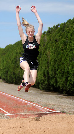 OBA's Brooklyn Wiens competes in the long jump at the Chisholm High School Boys and Girls Invitation Track and Field Meet Friday, April 12, 2013. (Staff Photo by BONNIE VCULEK)