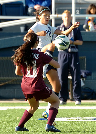 Enid's Abigail Resendiz leaps to gain control of the ball in front of Jenks' Kaylee Dao Thursday at D. Bruce Selby Stadium. (Staff Photo by BILLY HEFTON)