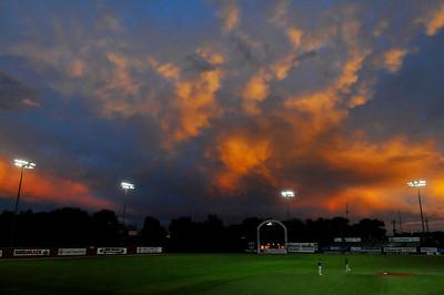 Brillant sunset Friday at David Allen Memorial Ballpark during the Merrifield Tournament. (Staff Photo by BILLY HEFTON)
