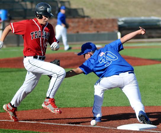 OBA's Thomas Friesen reaches first against Cimarron's Mason Bode during the Merrifield Office Supply Baseball Tournament at David Allen Memorial Ballpark Saturday, April 18, 2015. (Staff Photo by BONNIE VCULEK)