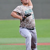 Muskogee's #20 delivers a pitch against Enid Monday April 18, 2016 at David Allen Ballpark. (Billy Hefton / Enid News & Eagle)