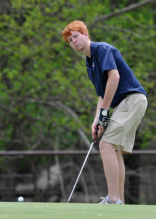 Enid's Alex Vaverka watches his putt from the edge of the 14th green during the Enid Invitational Tournament Monday April 18, 2016 at Meadowlake Golf Course. (Billy Hefton / Enid News & Eagle)