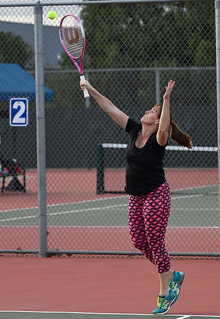 Tammy Smoot serves during the Enid Tennis Association play night at the Crosslin Park tennis courts Thursday April 20, 2017. (Billy Hefton / Enid News & Eagle)