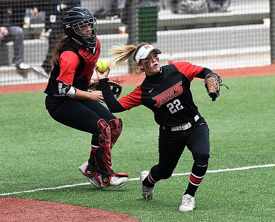 NOC Enid catcher, Tori Danielson looks on as Kaylon Dunn makes a throw to first after fielding a bunt against NOC Tonkawa Saturday April 22, 2017 at David Allen Memorial Ballpark. (Billy Hefton / Enid News & Eagle)