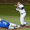 Enid's Ambren Voitik throws over Stillwater's Tyler Watson for an attempted double play during the Gladys Winters Tournament Thursday April 7, 2017 at David Allen Ballpark. (Billy Hefton / Enid News & Eagle)