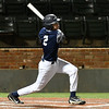 Enid's Mason Skrimager hits a double against Putnam City North during the Gladys Winters Tournament Thursday April 6, 2017 at David Allen Ballpark. (Billy Hefton / Enid News & Eagle)