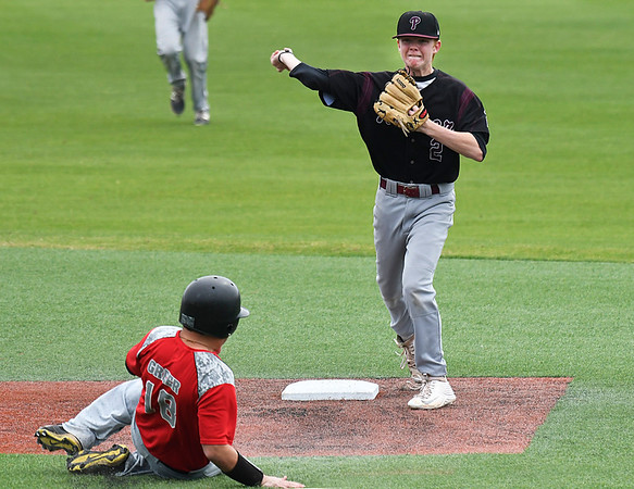 Pioneer's Layken Young throws over Watonga's G.R. Greer for an attempted double play during the opening game of the Merrifield Office Supply Tournament Thursday April 13, 2017 at David Allen Memorial Ballpark. (Billy Hefton / Enid News & Eagle)