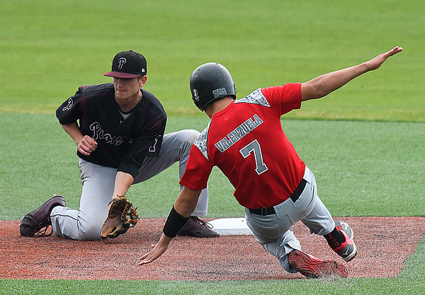Pioneer's Kade Cronkhite waits on the ball to tag out Watonga's Jordan Valenzuela during the opening game of the Merrifield Office Supply Tournament Thursday April 13, 2017 at David Allen Memorial Ballpark. (Billy Hefton / Enid News & Eagle)