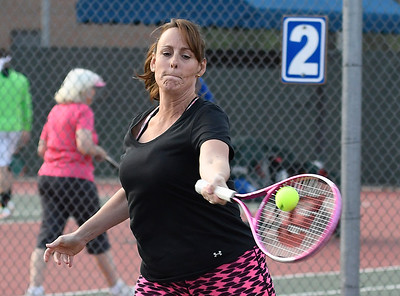 Tammy Smoot returns a shot during the Enid Tennis Association play night at the Crosslin Park tennis courts Thursday April 20, 2017. (Billy Hefton / Enid News & Eagle)