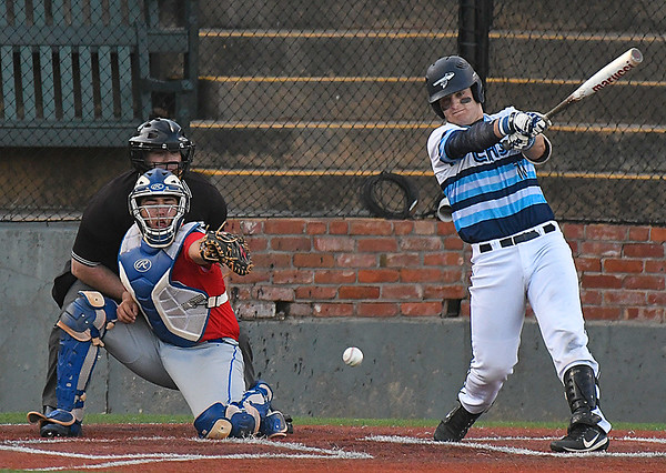 Enid's Kros Bay hits a single against Moore Tuesday April 11, 2017 at David Allen Memorial Ballpark. (Billy Hefton / Enid News & Eagle)