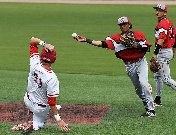 NOC Enid's Carlos Andujar throws over Tanner Long of NOC Tonkawa for a double play Thursday April 20, 2017 at David Allen Memorial Ballpark. (Billy Hefton / Enid News & Eagle)