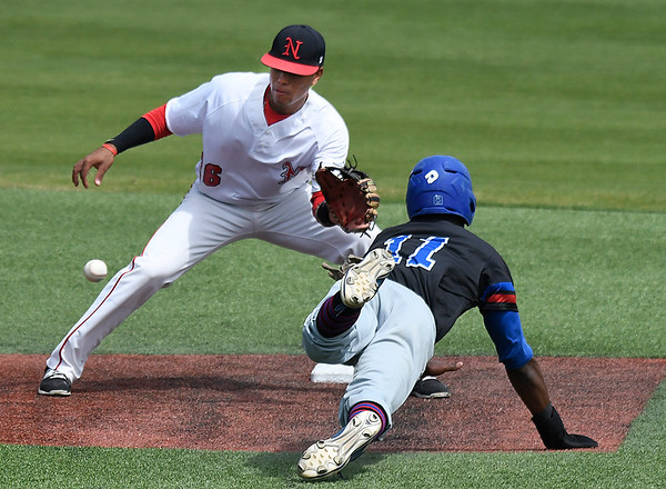 NOC Enid's Carlos Andujar waits on the ball to tag out Carl Albert's Nathanel Makaya-Richardson trying to steal second base Wednesday April 12, 2017 at David Allen Memorial Ballpark. (Billy Hefton / Enid News & Eagle)