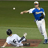 Stillwater's Ryan Vilade throws over Enid's Colton Troxel for a double play during the Gladys Winters Tournament Thursday April 7, 2017 at David Allen Ballpark. (Billy Hefton / Enid News & Eagle)