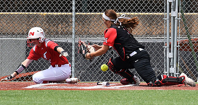 NOC Tonkawa's Savanah Mundell scores as the ball gets away from NOC Enid's Tori Danielson Saturday April 22, 2017 at David Allen Memorial Ballpark. (Billy Hefton / Enid News & Eagle)