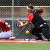 NOC Tonkawa's Savanah Mundell scores as the ball gets away from NOC Enid's Tori Danielson Saturday April 22, 2017 at David Allen Memorial Ballpark. (Billy Hefton / Enid News & Eagle)