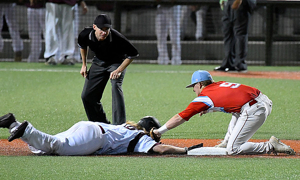 Chisholm's Connor Pasby tags out Pioneer's Gunner Coffey at second during the championship game of the Merrifield Office Plus Invitational Saturday April 15, 2017 at David Allen Memorial Ballpark. (Billy Hefton / Enid News & Eagle)