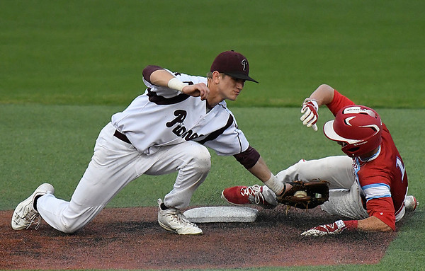 Pioneer's Kade Cronkhite tags out Chisholm's Scott Grebe during the championship game of the Merrifield Office Plus Invitational Saturday April 15, 2017 at David Allen Memorial Ballpark. (Billy Hefton / Enid News & Eagle)