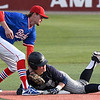 Enid's Titan Stephens slides into second with a double ahead of the tag from Bixby's Kyle Bass during the Gladys Winters Tournament Thursday April 5, 2018 at David Allen Memorial Ballpark. (Billy Hefton / Enid News & Eagle)