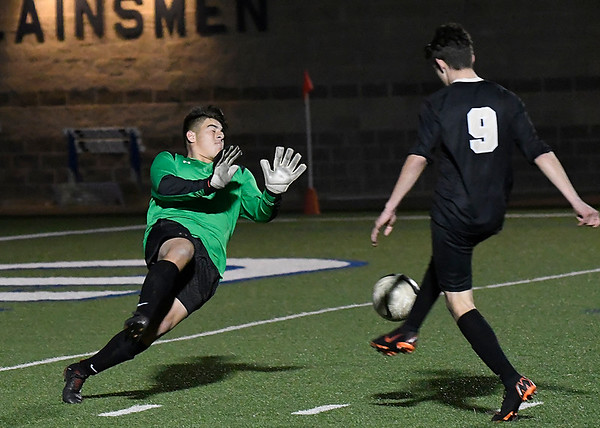 Broken Arrow's Mario Rivadavia knocks the ball pass Enid's Angel Neri for the Tigers' second goal Monday April 2, 2018 at D. Bruce Selby Stadium. (Billy Hefton / Enid News & Eagle)