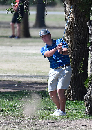 Enid's Jack Fossett hits onto the 9th green during a 6A regional tournament Monday at Meadowlake Golf Course. (Billy Hefton / Enid News & Eagle)