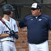 Enid head coach, Brad Gore, talks with Braden Pierce during a game against Muskogee Monday April 16, 2018 at David Allen Memorial Ballpark. (Billy Hefton / Enid News & Eagle)