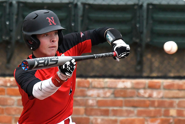 NOC Enid's D.J. Calvert squares around to bunt against Connors State Monday April 2, 2018 at David Allen Memorial Ballpark. (Billy Hefton / Enid News & Eagle)