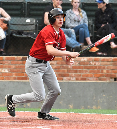 OBA's Blaine Bergdall gets a base hit against Dover during the Merrifield Office Supply Tournament Friday April 13, 2018 at David Allen Memorial Ballpark. (Billy Hefton / Enid News & Eagle)