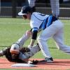 Enid's Ambren Voitik tags Putnam City's Kase Spybuck at second base Thursday April 19, 2018 at David Allen Memorial Ballpark. (Billy Hefton / Enid News & Eagle)