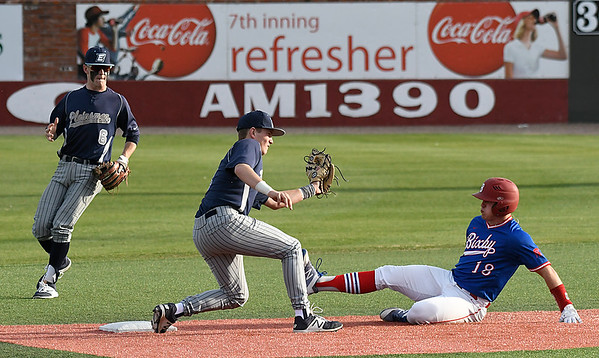 Enid's Ambren Voitik backs up Connor Gore as Gore tags out Bixby's Tucker Pawley during the Gladys Winters Tournament Thursday April 5, 2018 at David Allen Memorial Ballpark. (Billy Hefton / Enid News & Eagle)