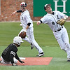 Enid's Connor Gore throws over Union's Landen Wood to complete a doubleplay during the Gladys Winters Tournament Friday April 6, 2018 at David Allen Memorial Ballpark. (Billy Hefton / Enid News & Eagle)