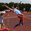 Chisholm's Tyrese Travis competes in the high jump during the Chisholm Invitational Friday April 13, 2018 at Chisholm High School. (Billy Hefton / Enid News & Eagle)