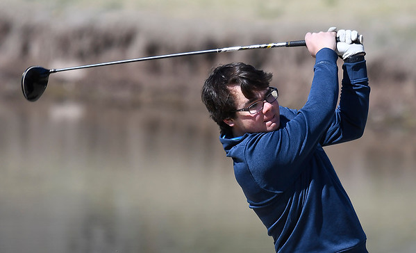 Enid's Riley Davis hits his tee shot on the 12th hole during the Enid Invitational Tournament Monday April 16, 2018 at Meadowlake Golf Course. (Billy Hefton / Enid News & Eagle)