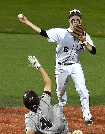 Enid's Ambren Voitik throws over Jenks' Torre Alavanja for a doubleplay Tuesday April 10, 2018 at David Allen Memorial Ballpark. (Billy Hefton / Enid News & Eagle)