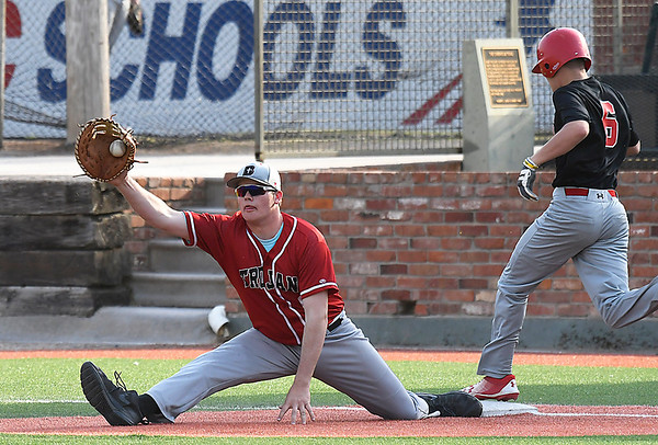 OBA's Montel Meyer stretches to put out Dover's Andrew Meeks during the Merrifield Office Supply Tournament Friday April 13, 2018 at David Allen Memorial Ballpark. (Billy Hefton / Enid News & Eagle)