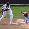 Chisholm's London McKee slides into second base ahead of the tag from Pioneer's Payton Wingo Tuesday April 3, 2018 at Pioneer High School. (Billy Hefton / Enid News & Eagle)