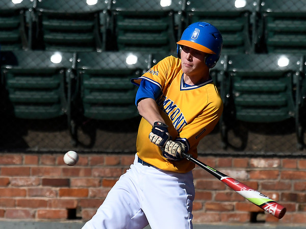 Drummond's Wyatt Gray gets a base hit against Garber in the opening game of the Merrifield Office Supply Tournament at David Allen Memorial Ballpark Thursday April 12, 2018. (Billy Hefton / Enid News & Eagle)