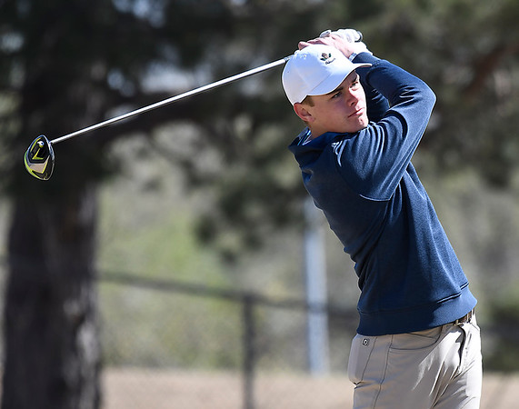 Enid's Eathan Armstrong hits his tee shot on the 13th hole during the Enid Invitational Tournament Monday April 16, 2018 at Meadowlake Golf Course. (Billy Hefton / Enid News & Eagle)