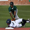 Enid's Connor Gore keeps his hand on second base as Muskogee's Devonte Gandy applies a tag Monday April 16, 2018 at David Allen Memorial Ballpark. (Billy Hefton / Enid News & Eagle)