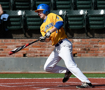 Drummond's Brandon Coontz gets a base hit against Garber in the opening game of the Merrifield Office Supply Tournament at David Allen Memorial Ballpark Thursday April 12, 2018. (Billy Hefton / Enid News & Eagle)
