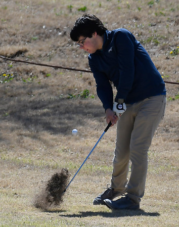 Enid's Riley Davis hits a shot from the 14th fairway during the Enid Invitational Tournament Monday April 16, 2018 at Meadowlake Golf Course. (Billy Hefton / Enid News & Eagle)