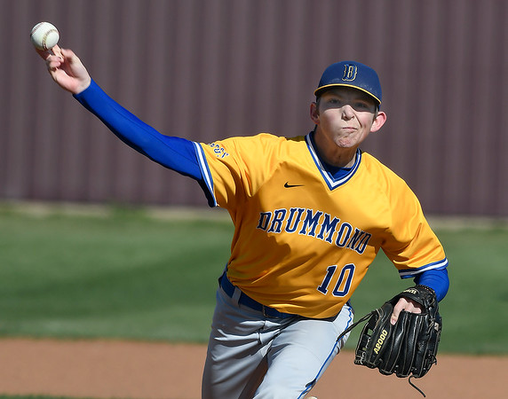 Drummond's Garrett Pool delivers a pitch against Pond Creek-Hunter at Pioneer High School during the second day of the Merrifield Tournament Friday April 12, 2019. (Billy Hefton / Enid News & Eagle)