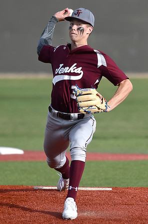 Jenks's Bryce Osmond throws a pitch against Enid Tuesday April 9, 2019 at David Allen Memorial Ballpark. (Billy Hefton / Enid News & Eagle)