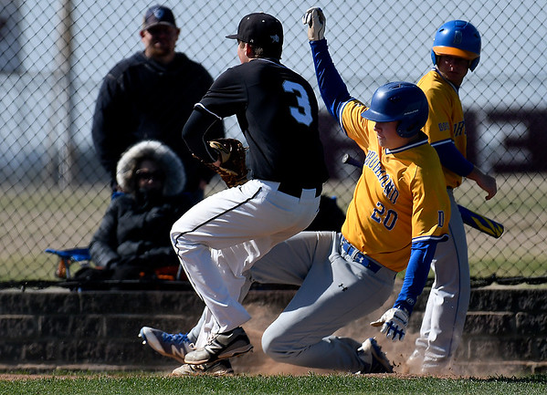 Drummond's Cole Bridges slides into home in front of Pond Creek-Hunter's Jon McGrath at Pioneer High School during the second day of the Merrifield Tournament Friday April 12, 2019. (Billy Hefton / Enid News & Eagle)
