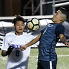 Enid's Alex Ramirez gains control of the ball in front of Bixby's Salvador Maldonado Friday April 12, 2019 at D. Bruce Selby Stadium. (Billy Hefton / Enid News & Eagle)