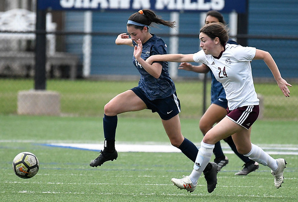 Enid's Angel Nash tries to pull away from Jenks' Hayley Garcia Tuesday April 16, 2019 at D. Bruce Selby Stadium. (Billy Hefton / Enid News & Eagle)